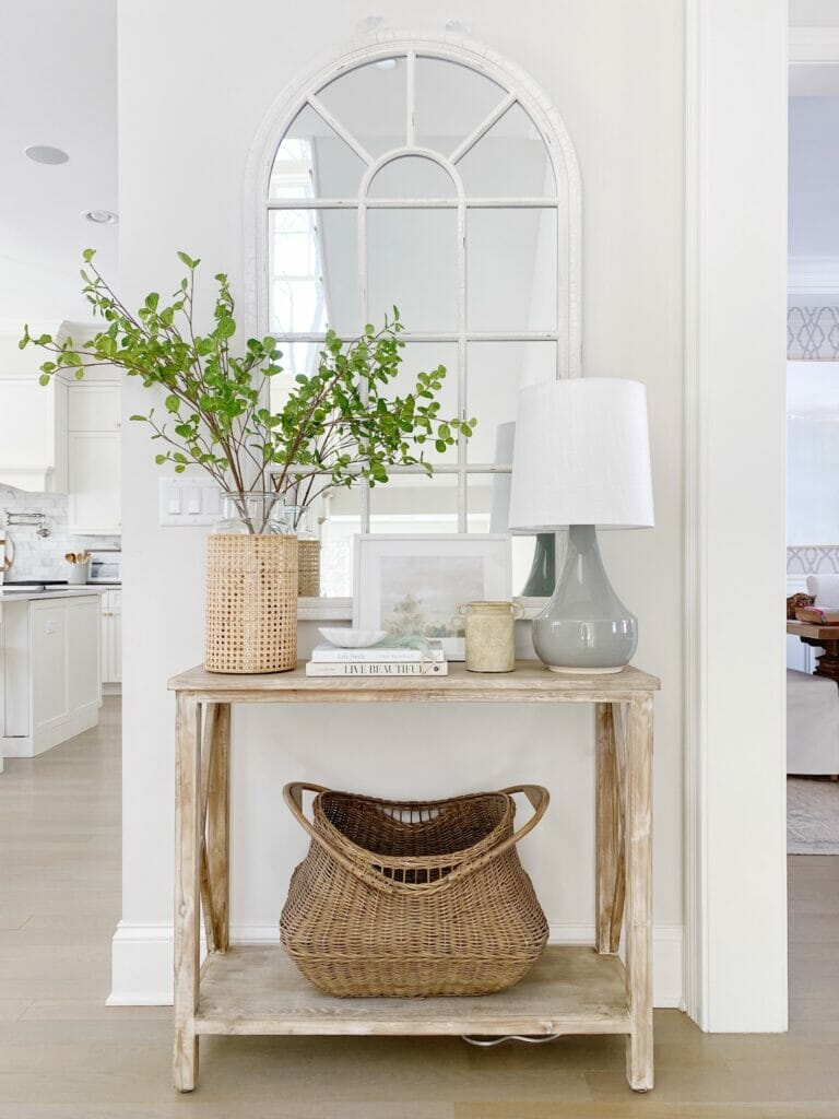 Console and entryway table styling, arched mirror, pretty decor finds, faux greenery, functional storage all help to create a beautiful and welcoming entryway.