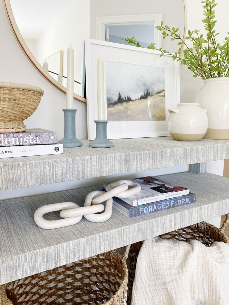Console and entryway table styling, sharing my favorite Serena & Lily Blake console table styled with a round mirror, pretty decor finds, faux greenery, and functional storage. Simply styling help create a beautiful and welcoming entryway.