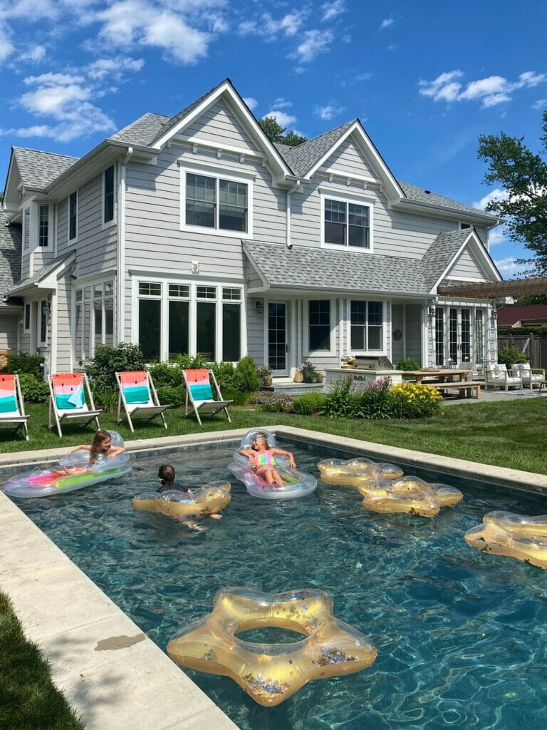 Backyard pool features pebble sheen finish in ocean blue.