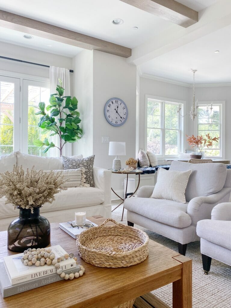 Neutral living room features warm earth tones and cozy textures for fall