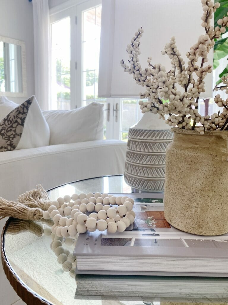 fall home decor features textured vase and lamp, wood beads and faux berry stems