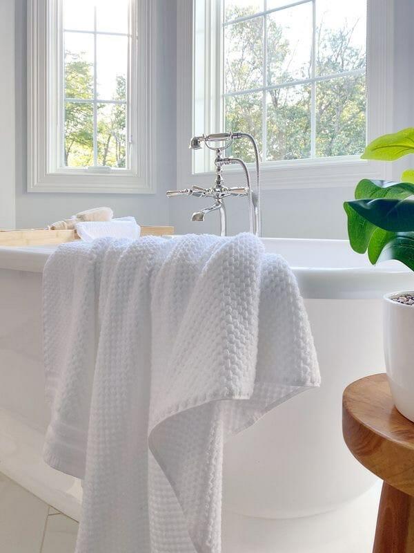 Gap Home bath towels, freestanding bath tub