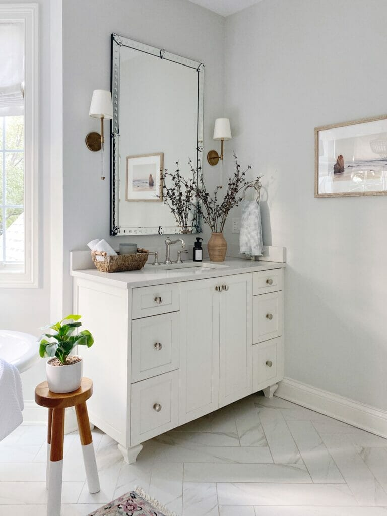 White cabinets, vanity mirror, and brass sconces | A Luxury Spa Retreat with Affordable Finds from Walmart